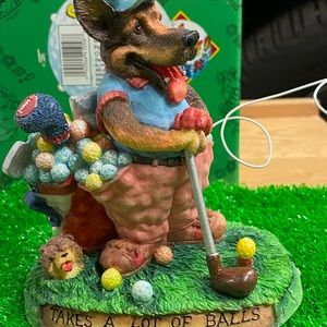Enesco New with box, dog playing golf statue.